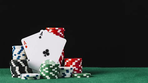 Stack of white; green; black and red casino chips with two